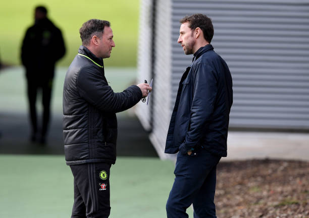 COBHAM, ENGLAND - FEBRUARY 16:  Steve Holland of Chelsea talks to England manager Gareth Southgate before a training session at Chelsea Training Ground on February 16, 2017 in Cobham, England. (Photo by Darren Walsh/Chelsea FC via Getty Images)